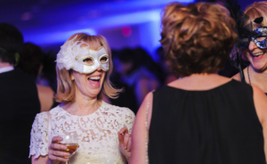Corporate event photo with holiday masquerade ball