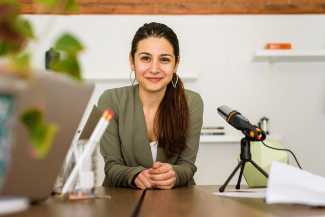 Friendly small business owner photo at desk